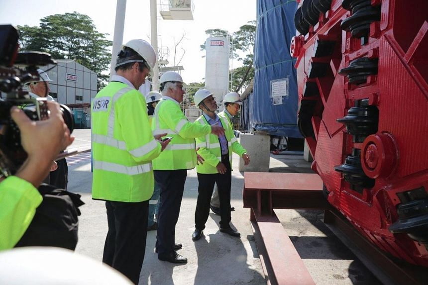 (From left) German Ambassador Dr Ulrich, founder and chairman of Board Herrenknecht Martin Herrenknecht, Minister for the Environment and Water Resources Masagos Zulkifli and PUB chief executive Ng Joo Hee touring the site of Tunnel Boring Machine at