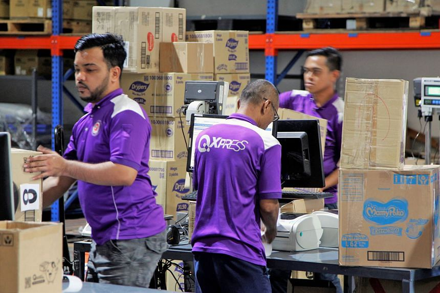 Qoo10's sorting and delivery facility in Toh Guan. The e-commerce company's share of Singapore's online shopping market more than quadrupled to 38.2 per cent from 2013 to last year, according to Euromonitor. It has held on to its leading position wit