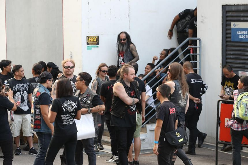 Swedish black metal band Watain mingling with fans on March 7, 2019, after their performance was cancelled.
