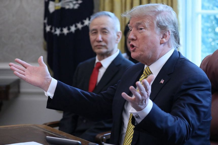 US President Donald Trump speaks while meeting China's Vice-Premier Liu He in the Oval Office of the White House.