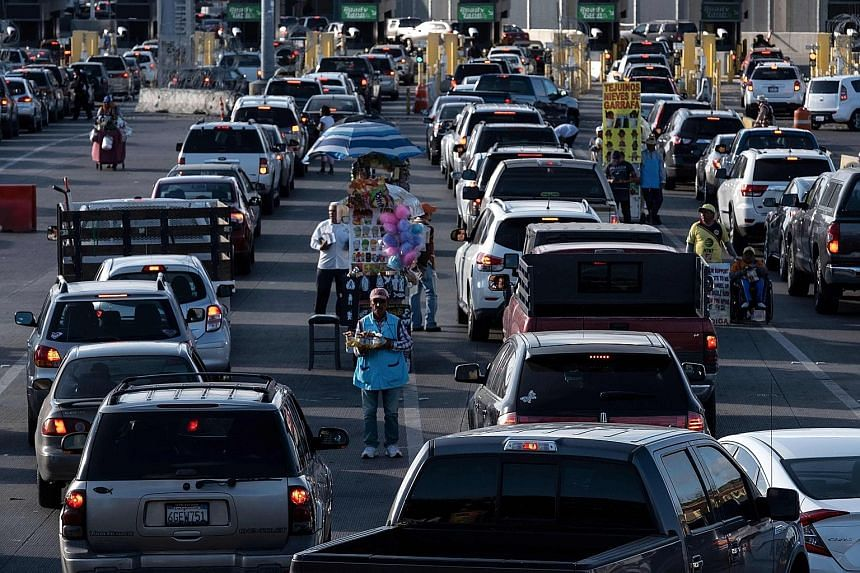 Cars queueing to cross into San Diego, in the United States, from Tijuana, Mexico, at the San Ysidro crossing port.