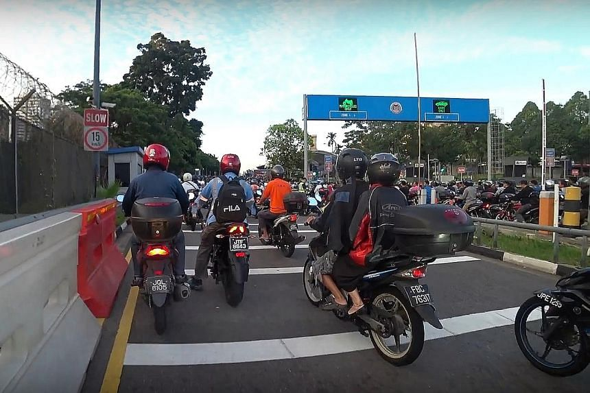 Motorcyclists heading to Singapore across the Causeway yesterday morning. While Malaysian media reported that congestion at the Causeway and Tuas Checkpoint on Monday was worse than usual, an app tracking the jams said the only difference was that Mo