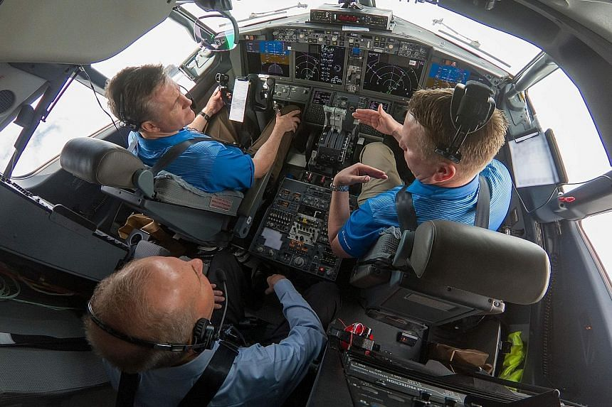 Boeing chief executive Dennis Muilenburg (in rear seat) participating in a flight demonstration with updated MCAS software on a B-737 Max plane on Wednesday. Boeing said it successfully tested the update of the software, designed to reduce its author