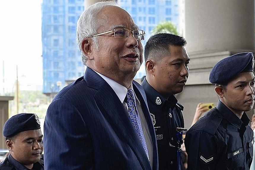 Malaysia's former prime minister Najib Razak outside the Kuala Lumpur High Court on Wednesday, the start of his trial linked to the alleged plundering of state fund 1MDB.