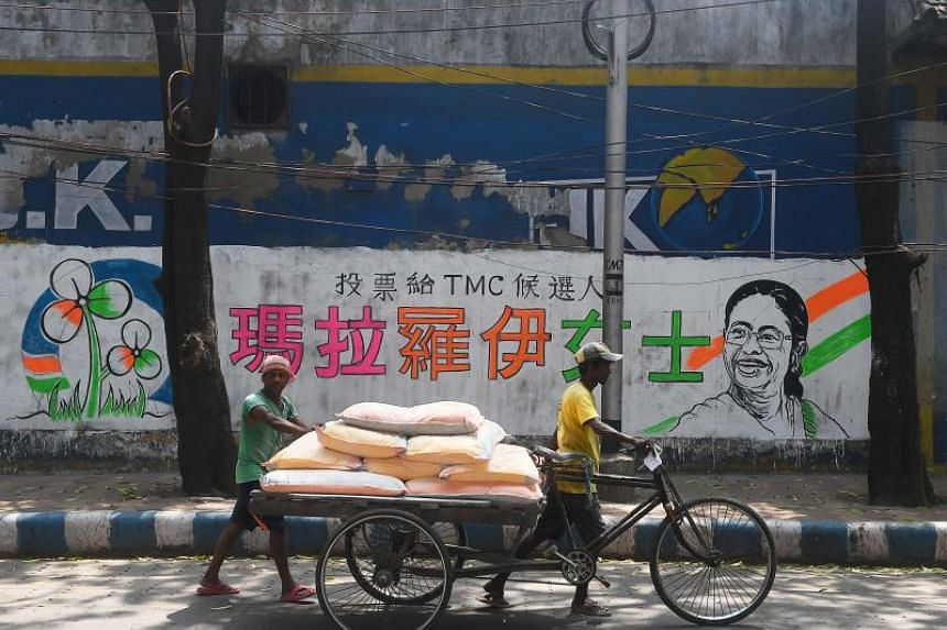 Election campaign messages in Chinese characters are being used for the first time in the bustling metropolis of Kolkata.