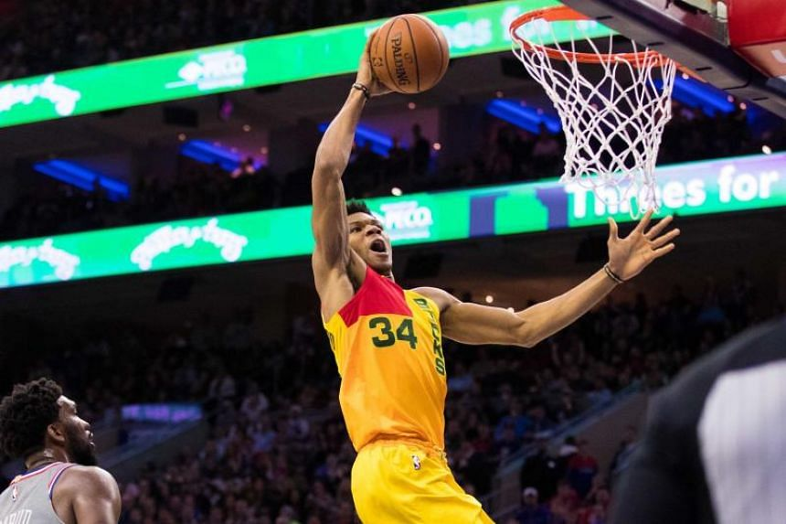 Giannis Antetokounmpo scored 45 points as the Milwaukee Bucks clinched the best record in the NBA's Eastern Conference with a 128-122 victory over the Philadelphia 76ers on April 4, 2019.