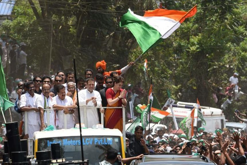 Mr Rahul Gandhi, president of India's main opposition Congress party, and his sister Priyanka Gandhi Vadra greet their supporters after Mr Gandhi filed his nomination papers for the general election in Wayanad, India, on April 4, 2019.