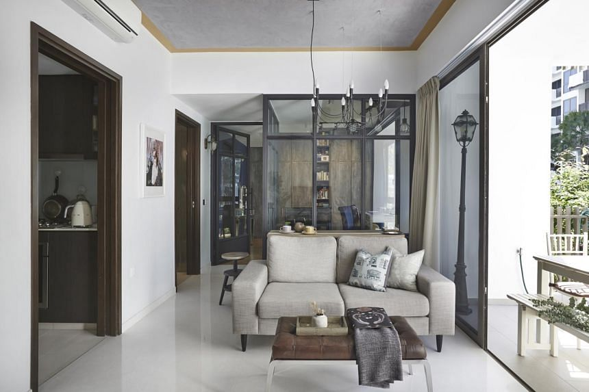 Replacing concrete walls with glass panels is just one way to make the apartment look and feel larger than it is.