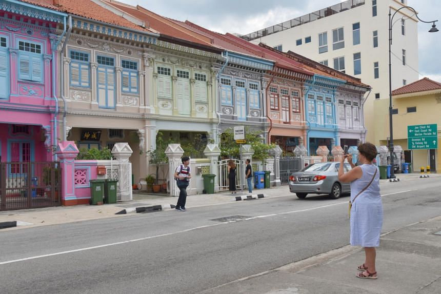 Tourists taking photographs along the houses in Koon Seng Road, on April 4, 2019.
