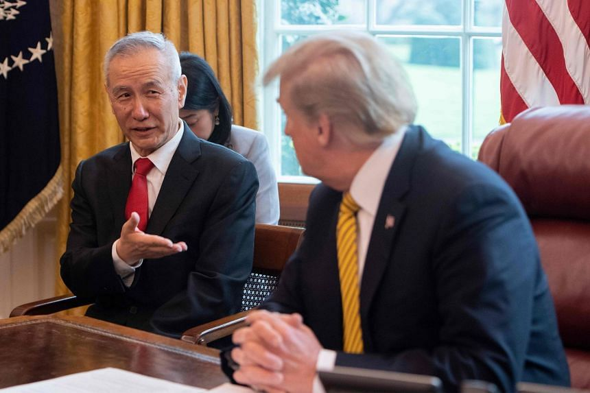 China's Vice-Premier Liu He (left) with US President Donald Trump at the White House.