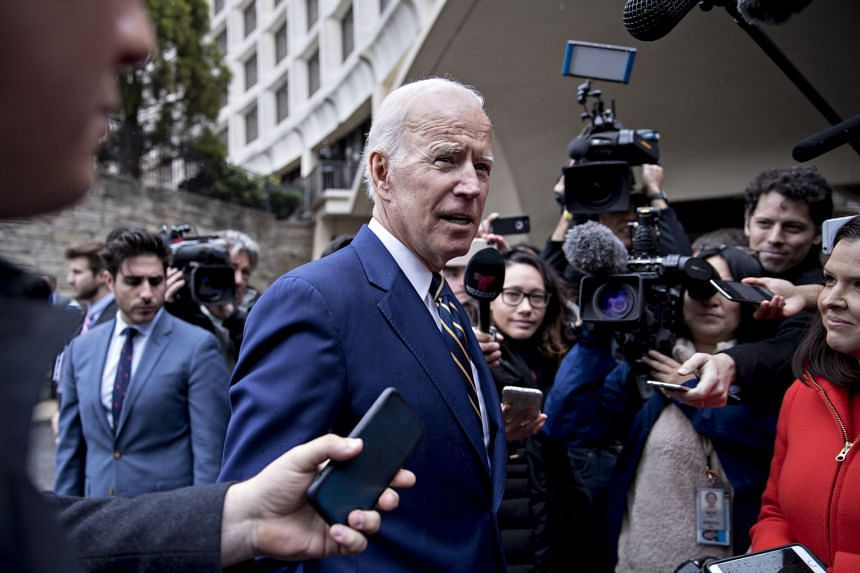 Biden speaks to members of the media after speaking at a union conference in Washington.