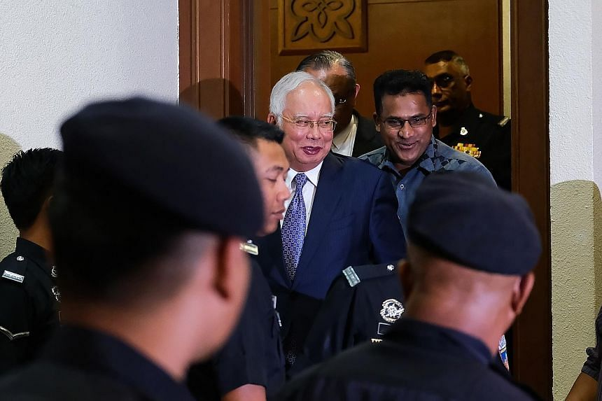 Former Malaysian prime minister Najib Razak exiting a court room at the Kuala Lumpur Courts Complex on Wednesday. He is alleged to have received RM42 million in his personal account from SRC International.