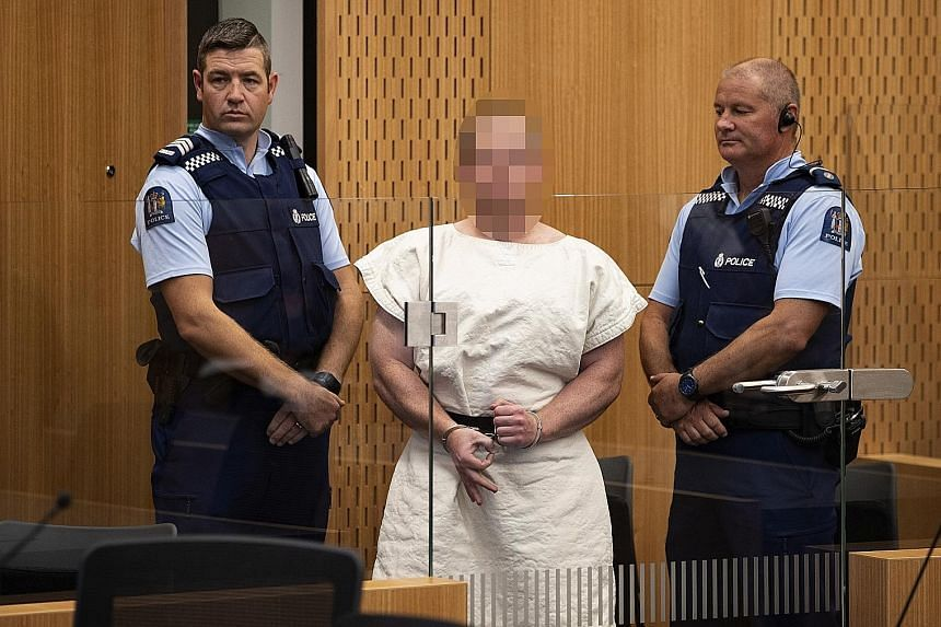 Brenton Tarrant making a sign to the camera during his appearance, on a charge of murder for the Christchurch mosque massacres, in a District Court last month. The media is allowed to publish only pixellated images of Tarrant.