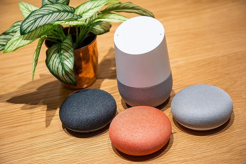 The Google Home speaker (above in white, seen with Home Mini speakers) allows you to play music, among other things, through an app.