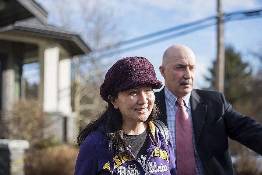 Huawei and its chief financial officer, Meng Wanzhou (left), are accused of conspiring to defraud HSBC Holdings and other banks by misrepresenting Huawei's relationship with Skycom Tech, a suspected front company that operated in Iran.