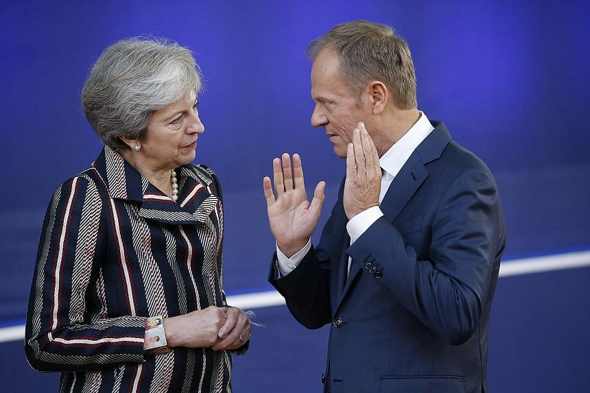 British Prime Minister Theresa May meeting European Council President Donald Tusk at a summit in Brussels last year. Mr Tusk, who will convene a meeting of EU leaders on Wednesday, plans to propose a longer Brexit postponement of one year for Britain