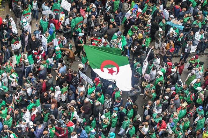 Algerians gather during an anti-government demonstration in the capital Algiers, on April 5, 2019.