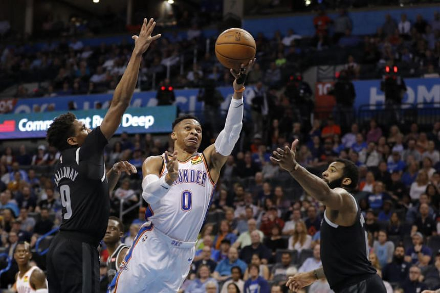 Oklahoma City Thunder's Russell Westbrook shoots during the game against the Detroit Pistons at the Chesapeake Energy Arena.