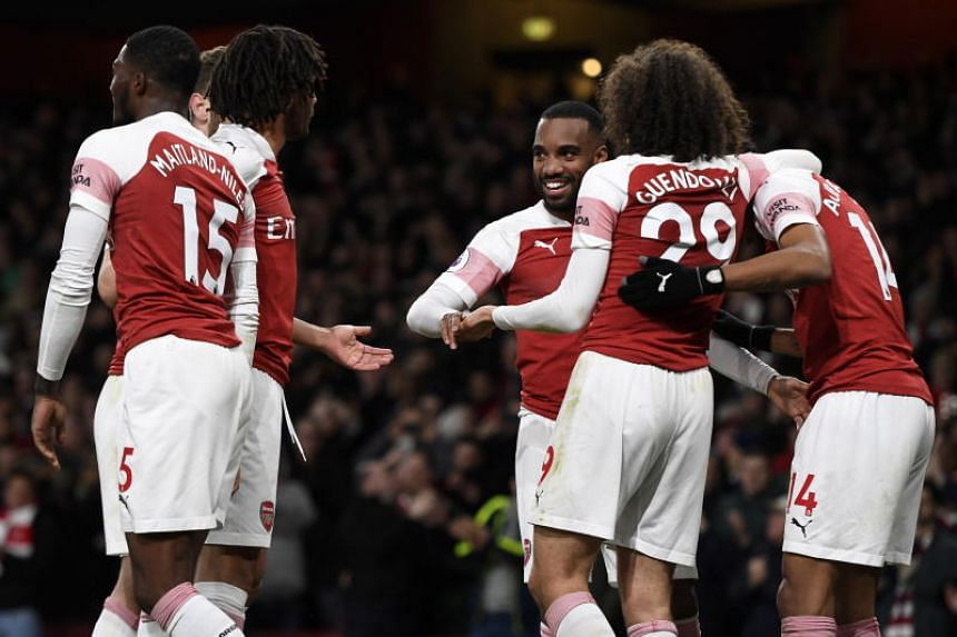 Arsenal's Alexandre Lacazette (centre) celebrates with teammates after scoring during their English Premier League match against Newcastle United at Emirates Stadium in London on April 1, 2019.