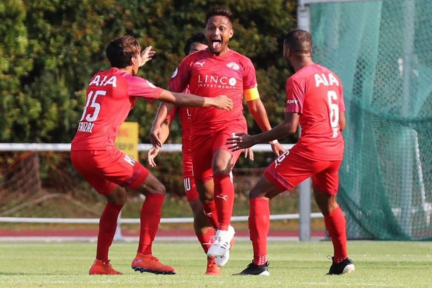Home United's Izzdin Shafiq (centre) celebrates after scoring a goal against the Young Lions.
