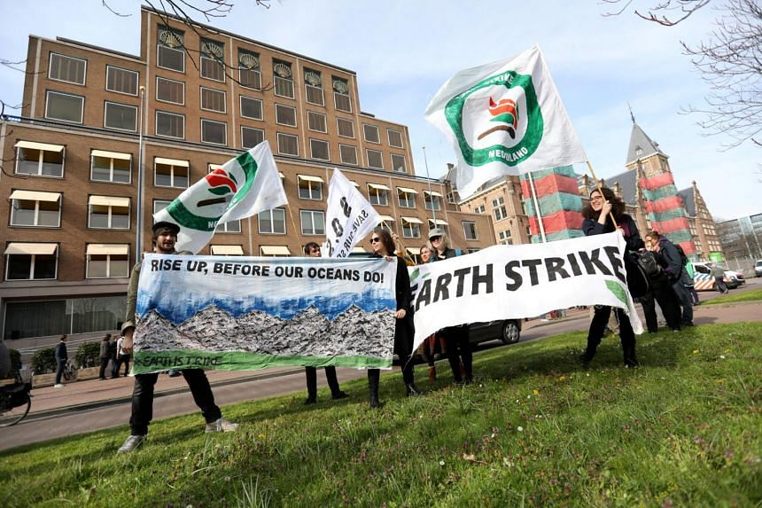 Environmentalist and human rights groups demand Royal Dutch Shell to stop the extraction of oil and gas, outside of its headquarters in The Hague, Netherlands, on April 5, 2019.