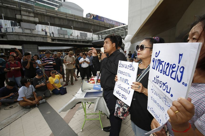 Thai activists seeking support for a petition to dissolve the Election Commission, outside the Bangkok Art and Culture Centre yesterday.