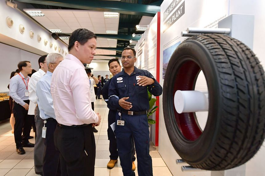 Trade and Industry Minister Chan Chun Sing being briefed by ExxonMobil engineer Ramkiran Mattupalli at the opening ceremony of the energy giant's butyl rubber and resins plants on Jurong Island yesterday. One of the plants will produce premium halobu