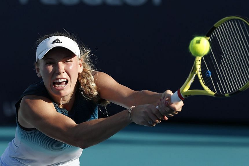 Wozniacki (above, in a file photo) maintained her streak of never having lost a set to Martic in six meetings.