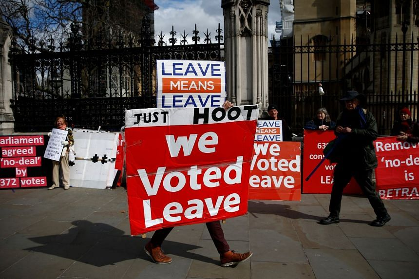 A pro-Brexit protester demonstrates outside the Houses of Parliament in London, as Brexit wrangles continue.