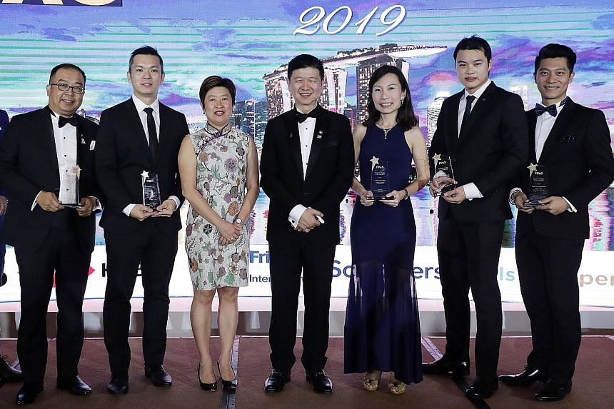 At the Financial Planning Association of Singapore Financial Planner Awards 2019 on Friday were (from left): Mr Eric Seah of Prudential Assurance; Mr Zed Xiao of Financial Alliance; Ms Merlyn Ee, executive director of the Monetary Authority of Singap