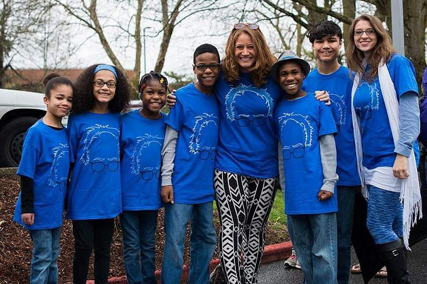 Ms Jennifer Hart and her partner Sarah Margaret Hart (far right) with their six adopted children (from left) Hannah, Abigail, Ciera, Jeremiah, Devonte and Markis in Vancouver, Washington, in 2016. The family died last year when their car (below) plun
