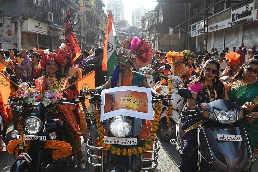 Indian women dressed in traditional attire riding motorcycles as they took part in a procession celebrating Gudhi Padwa, or the Maharashtrian New Year, in Mumbai yesterday. Gudhi Padwa is the Hindu New Year for people in India's Maharashtra state. It