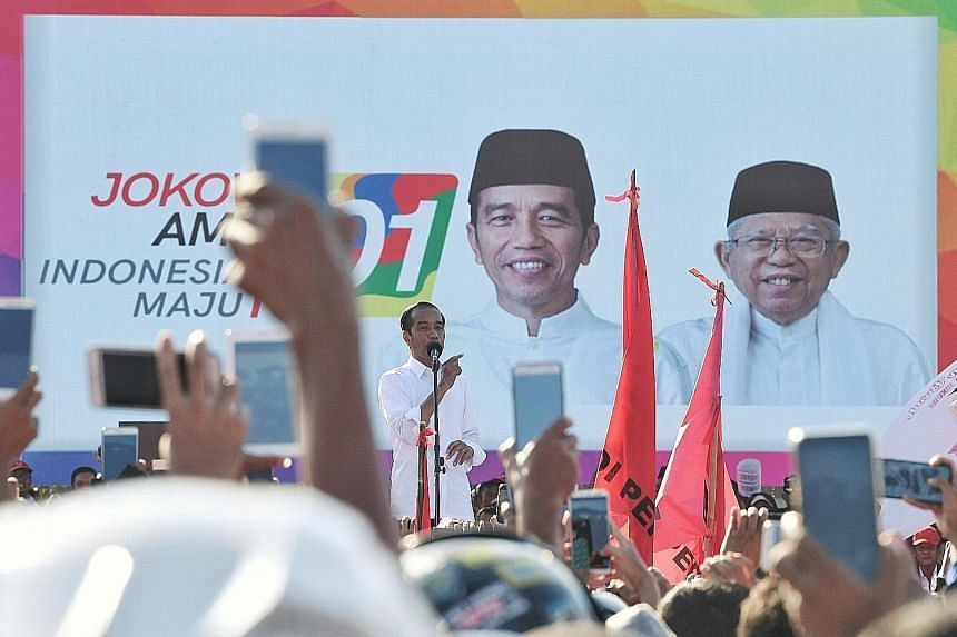 Indonesian President Joko Widodo making a point during his rally yesterday in Batam. He hoped the islanders will give him and his running mate Ma'ruf Amin at least 70 per cent of the votes.