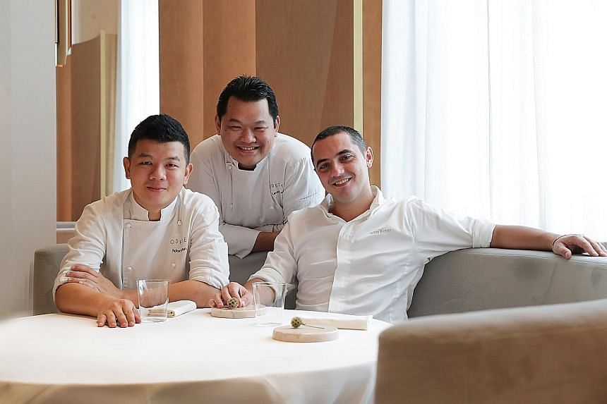 Odette's chef Julien Royer (right, with senior sou chefs Adam Wan, far left, and Levin Lau) says while his restaurant was ranked No. 1 on the Asia's 50 Best Restaurants list, what is better is that Odette has not had an empty table since Day One.
