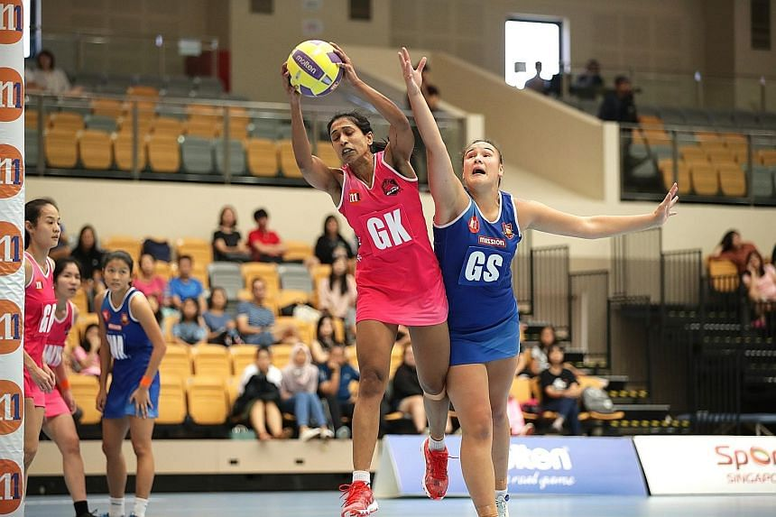 Mission Mannas' Rochelle Teiri challenging Blaze Dolphins' Premila Hirubalan for the ball at Our Tampines Hub yesterday. Defending champions Dolphins beat Mannas 52-39 for a spot in next Saturday's Netball Super League grand final.
