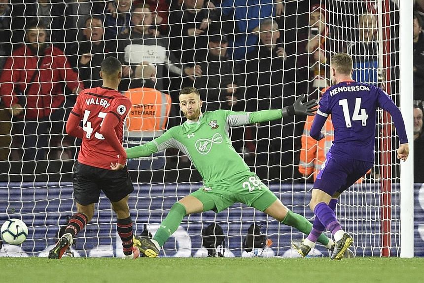 Top: Southampton's Shane Long putting the hosts ahead after just nine minutes in their match against Liverpool at St Mary's Stadium on Friday. Above: Liverpool captain Jordan Henderson scoring their third goal against Southampton. The Reds won 3-1.