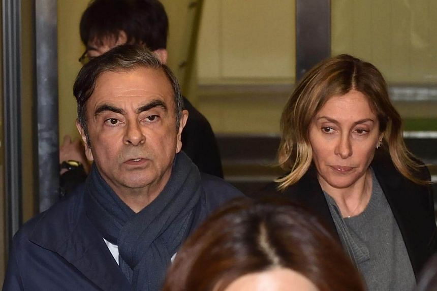 Former Nissan Chairman Carlos Ghosn (left) and his wife Carole outside his lawyer's office on April 3, 2019.  Prosecutors in Tokyo have asked judges to question the latter in connection with funds allegedly misappropriated by Ghosn.