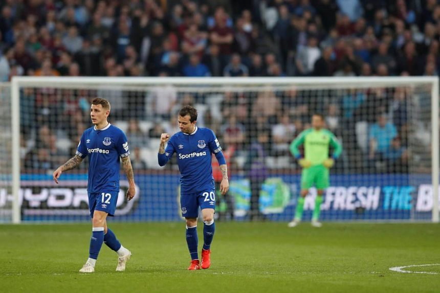 Everton players after their team score a goal during their English Premier League football match against West Ham United at The London Stadium, on March 30, 2019.