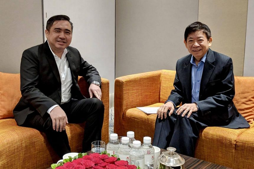 Transport Minister Khaw Boon Wan (right) and his Malaysian counterpart Anthony Loke said that Singapore will withdraw the Instrument Landing System procedures for Seletar Airport and Malaysia will indefinitely suspend its permanent restricted area ov