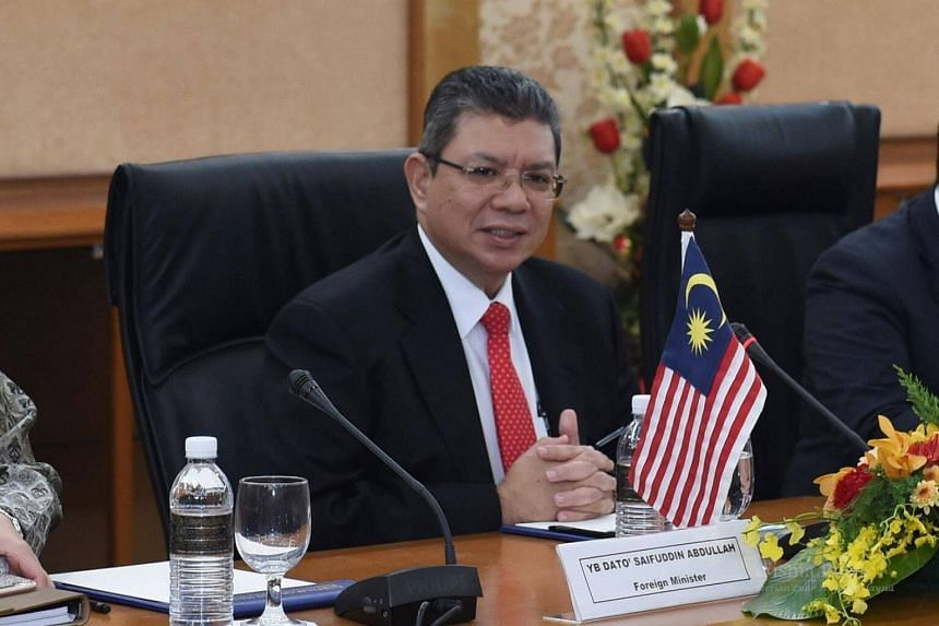 According to Malaysia's Foreign Minister Saifuddin Abdullah, the decision to withdraw from ratifying the Rome Statute of the International Criminal Court was a political move made to avoid a coup attempt.
