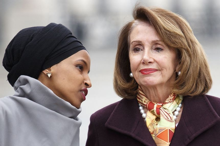Ilhan Omar (left) chats with Democratic House Speaker Nancy Pelosi during a news conference at the Capitol in March 2019.