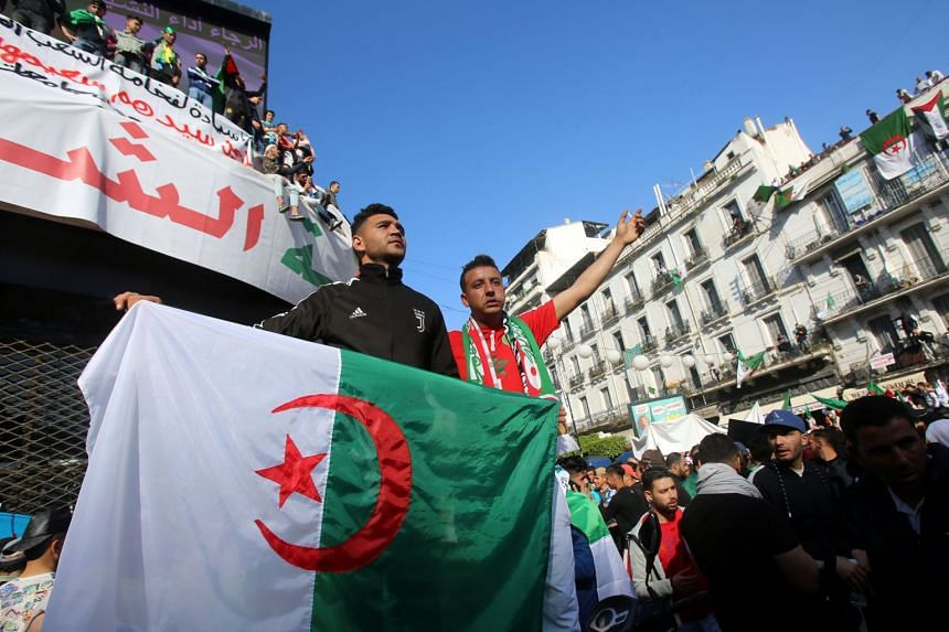 Protesters carrying the Algerian national flag in Algiers last Friday, following the resignation of president Abdelaziz Bouteflika after 20 years in power.