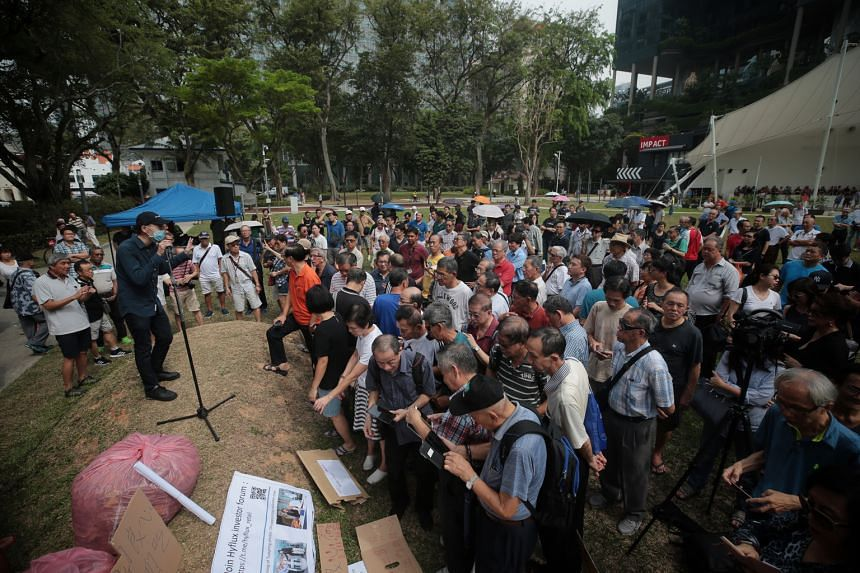 A group of Hyflux investors staging a protest (above) at the Speakers' Corner in Hong Lim Park on March 30 to vent their anger over the state of affairs at the troubled company.