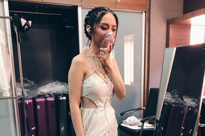 Hong Kong singer GEM getting oxygen during her performance in Genting.
