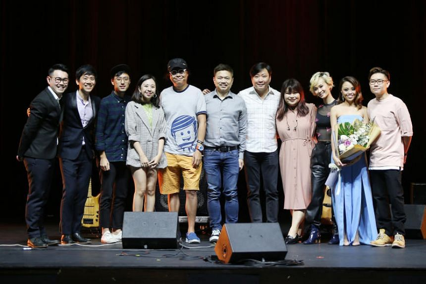 (From left) Sing Our Song host Ken Low, budding musicians Daniel Ong, Angus Sham, Ng Meiting, veteran musicians Eric Ng, George Leong, Jim Lim, budding musicians Ariane Goh, Becka, and guest singers Serene Koong and Wu Jiahui at the Capitol Theatre