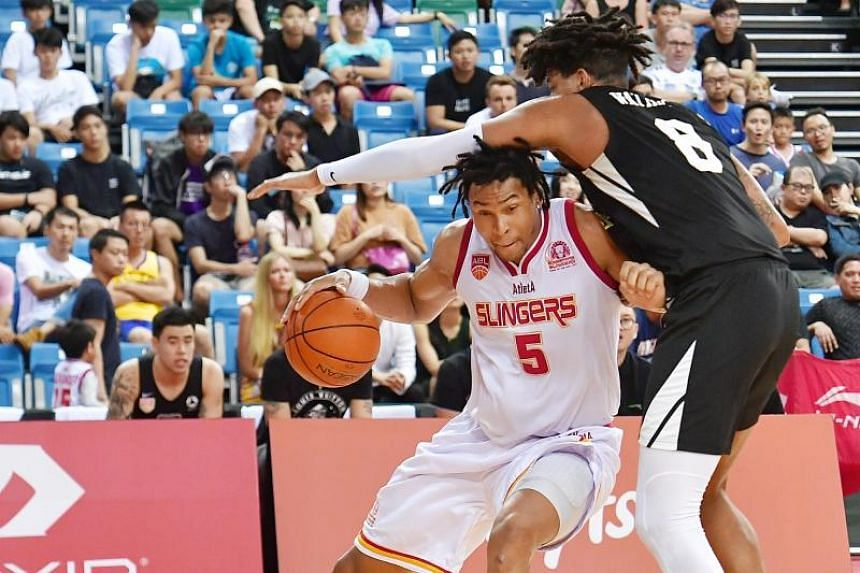 Singapore Slingers centre John Fields (left) backing down against Macau Black Bears centre Ryan Watkins during their ABL quarterfinals on April 7, 2019.