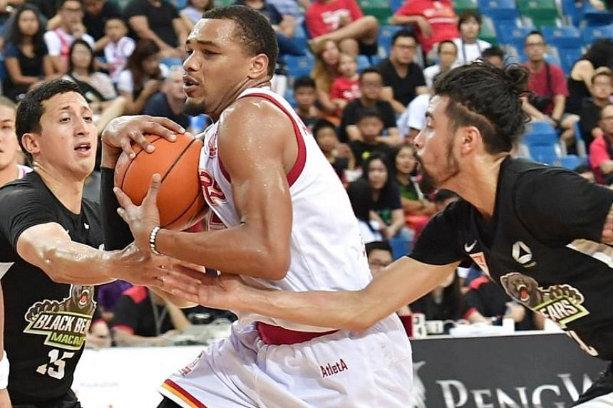 Singapore Slingers forward Xavier Alexander (centre) guarding the ball against Macau Black Bears guards Nathan Yu (left) and Mikhael Alexander McKinney during their ABL quarterfinals on April 7, 2019.