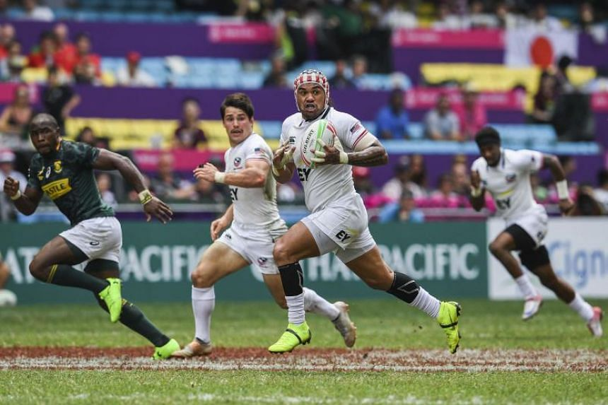 Folau Niua (centre right) of the United States running with the ball against South Africa during the Hong Kong Sevens rugby tournament on April 7, 2019.