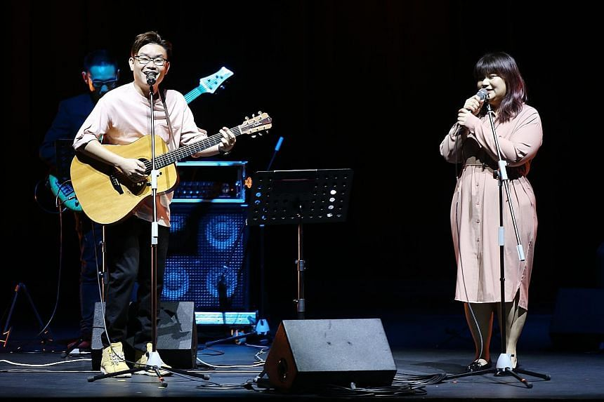 Musician Ariane Goh with Malaysian singer-songwriter Wu Jiahui, performing the song One Half, at the wrap-up of Sing Our Song.