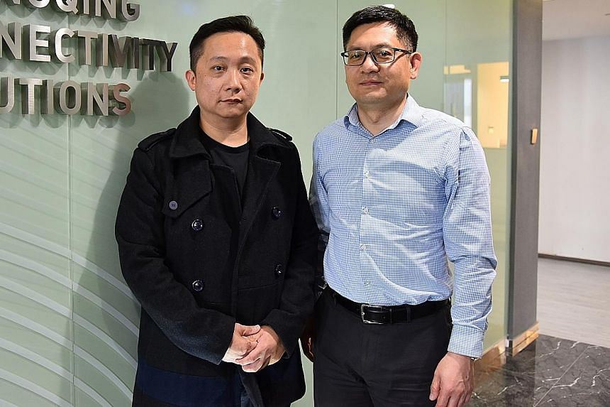 Above: Sino-Singapore Chongqing Connectivity Solutions general manager Gordon Tan (left) and Sino-Singapore (Chongqing) DC Multimodal Logistics deputy general manager Will Zhao. Below: Guoyuan Port, where the viability of routes to Europe and South-e